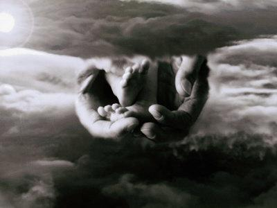 In the Clouds, Father's Hands Hold a Child's Feet