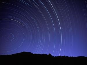 Star Trails Over Mountain Range in Utah by Chris Cheadle