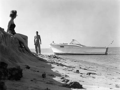 Couple Enjoying the Beach with their Chirs-Craft Boat by Chris-Craft
