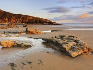 Sunset over Rocks with Flowing Water at Dunraven Bay, Southerndown, Wales by Chris Hepburn