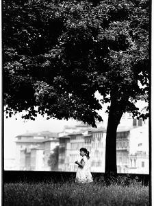 A Little Girl Picking Flowers in Florence, Italy by Chris Hill