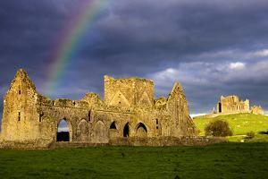 A Rainbow over Hore Abbey and the Rock of Cashel in County Tipperary by Chris Hill