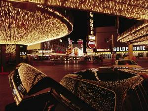 A Las Vegas Hotel's Neon Lights are Reflected on a Parked Car by Chris Johns