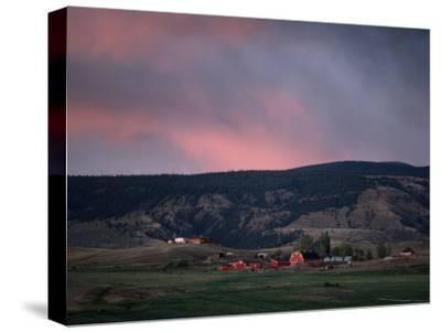 Farm Landscape with Red Barn and Hills at Twilight