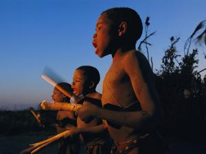 Newly Circumcised Boys from the Luvale Tribe Greet the Dawn by Chris Johns