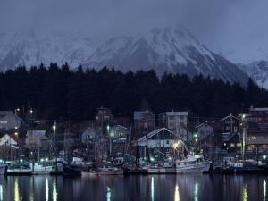 Quaint Fishing Village in the Shadow of Snow-Blanketed Mountains by Chris Johns