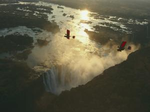 Ultralights Fly over Mile-Wide Victoria Falls on the Zambezi River by Chris Johns