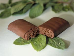Chocolate Nutrition Bar on Mint Leaves by Chris Rogers