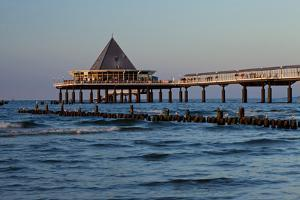 Germany, Western Pomerania, Island Usedom, Heringsdorf, Pier Restaurant, Afterglow Light by Chris Seba