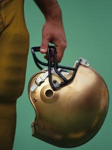 Football Player Holding His Helmet by Chris Trotman