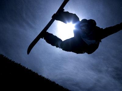 Silhouette of Male Snowboarder Flying over the Vert, Salt Lake City, Utah, USA