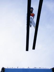 Ski Jumper in Action Flying Off the Lip of the Jump, Salt Lake City, Utah, USA by Chris Trotman