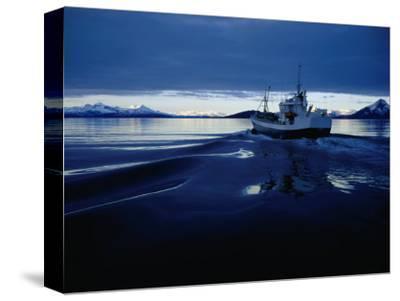Fishing Boat Plowing Through Calm Waters Outside of Lofoten, Lofoten, Nordland, Norway