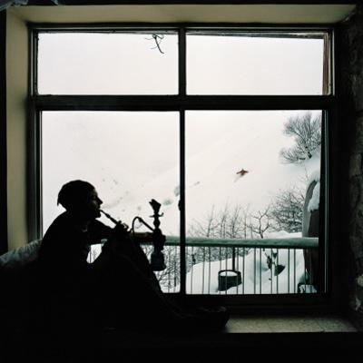 Man Smoking Water Pipe by Window, Alborz Mountain Range