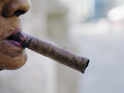 Profile of Cuban Woman Smoking Cigar in Vieja District