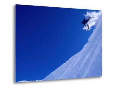 Skier Hurtling Over Cornice with Legs Apart, St. Anton Am Arlberg, Vorarlberg, Austria