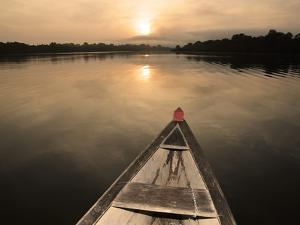Boat on the Amazon River, Near Puerto Narino, Colombia by Christian Heeb