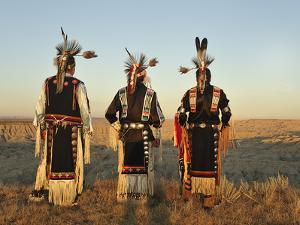 Lakota Indians in the Badlands of South Dakota, USA by Christian Heeb
