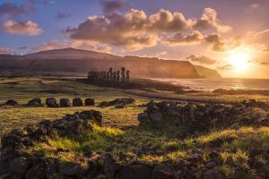 South America, Chile, Easter Island, Isla de Pascua, Moai stone human figures at sunrise by Christian Heeb