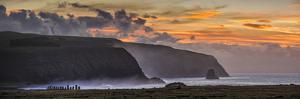 South America, Chile, Easter Island, Isla de Pascua, Moai stone human figures at sunrise by Christian Heeb