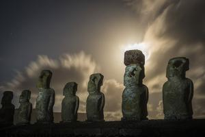South America, Chile, Easter Island, Isla de Pascua, Moai stone human figures under a  night sky at by Christian Heeb
