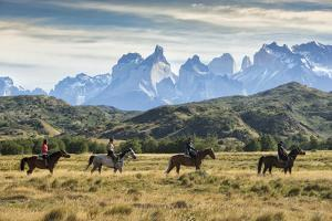 South America, Patagonia, Chile, Torres del Paine National Park, people on horseback in front of th by Christian Heeb