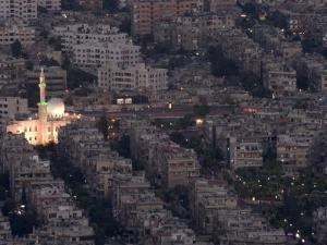Aerial View of City at Night Including a Floodlit Mosque, Damascus, Syria, Middle East by Christian Kober