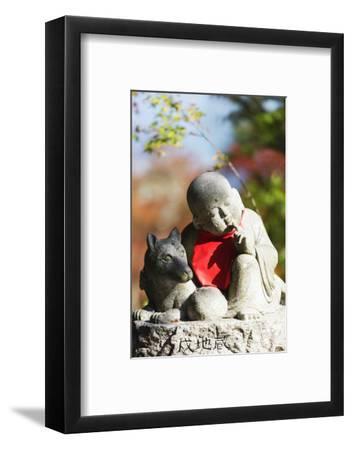 Asia, Japan, Honshu, Hiroshima Prefecture, Miyajima Island, Statue in Daisho in Temple
