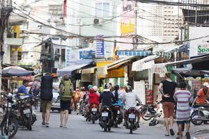 Backpackers on City Street, Ho Chi Minh City (Saigon), Vietnam, Indochina, Southeast Asia, Asia by Christian Kober