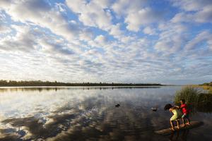 Clouds at sunset, Pangalanes Lakes canal system, Tamatave, eastern area, Madagascar, Africa by Christian Kober