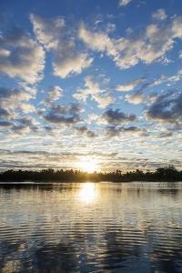 Clouds at sunset, Pangalanes Lakes canal system, Tamatave, Madagascar, Africa by Christian Kober