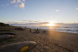 Dugout canoe on the beach, Tamatave, Indian Ocean coast, Madagascar, Africa by Christian Kober
