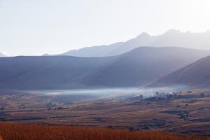 Early morning mist, Tsaranoro Valley, Ambalavao, central area, Madagascar, Africa by Christian Kober