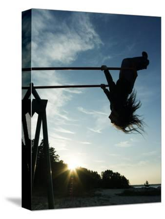 Girl Playing High on Swings at Sunset on Vosu Beach, Located in Lahemaa National Park