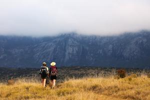Girls hiking on a trail, Andringitra National Park, Ambalavao, central area, Madagascar, Africa by Christian Kober
