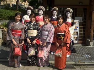 Girls Wearing Yukata, Kimono, Geisha, Maiko (Trainee Geisha) in Gion, Kyoto City, Honshu, Japan by Christian Kober