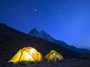 Illuminated Tents at Island Peak Base Camp, Sagarmatha National Park, Himalayas by Christian Kober