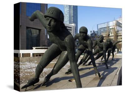 Northeast China, Heilongjiang Province, Harbin, A Statue of Female Ice Speed Skaters, China