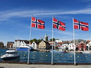 Norwegian Flags and Historic Harbour Warehouses, Stavanger, Norway, Scandinavia, Europe by Christian Kober