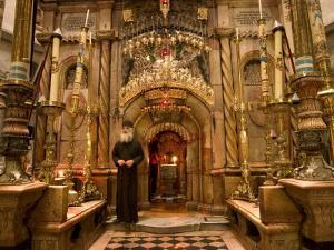 Priest at Tomb of Jesus Christ, Church of Holy Sepulchre, Old Walled City, Jerusalem, Israel by Christian Kober