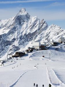Skiers, Mountain Scenery in Cervinia Ski Resort, Cervinia, Valle D'Aosta, Italian Alps, Italy by Christian Kober