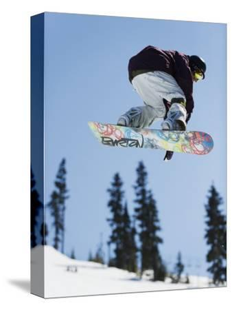 Snowboarder Jumping at Telus Half Pipe Competition 2009, Whistler Mountain