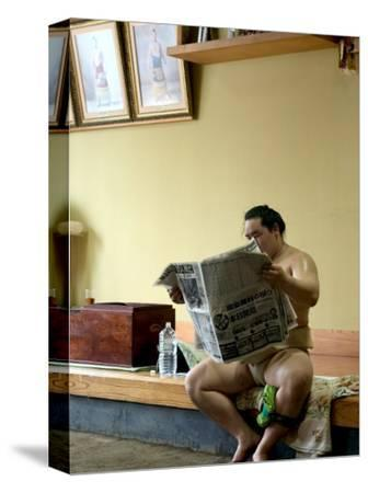 Sumo Wrestler Reading Newspaper, Tokyo City, Honshu Island, Japan
