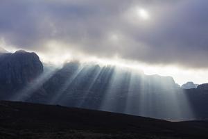 Sunrays breaking through cloud, Andringitra National Park, Ambalavao, central area, Madagascar, Afr by Christian Kober