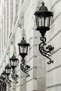 Lamps on Side of Building by Christian Peacock