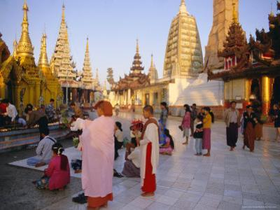 Buddhist Worshippers at the Shwedagon Paya (Shwe Dagon Pagoda), Yangon (Rangoon), Myanmar (Burma)