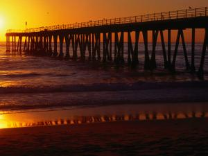 Golden Sun Sets over the Water and Pier at Hermosa Beach by Christina Lease