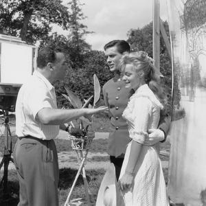 CHRISTINE, 1958 directed by PIERRE GASPARD-HUIT On the set, Pierre Gaspard-Huit directs Alain Delon