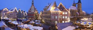 Christmas Market with the Old Town Hall and the St. Dionysius Church at Dusk