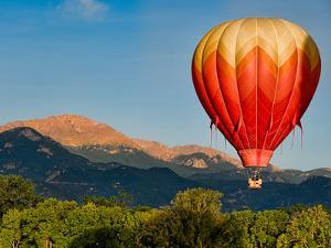 Hot Air Balloon Flies by Pikes Peak by Christopher Coleman